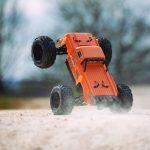 מכונית על שלט חשמלית 1/8 OUTCAST 6S BLX 4WD Brushless Stunt Truck with Spektrum RTR, Orange